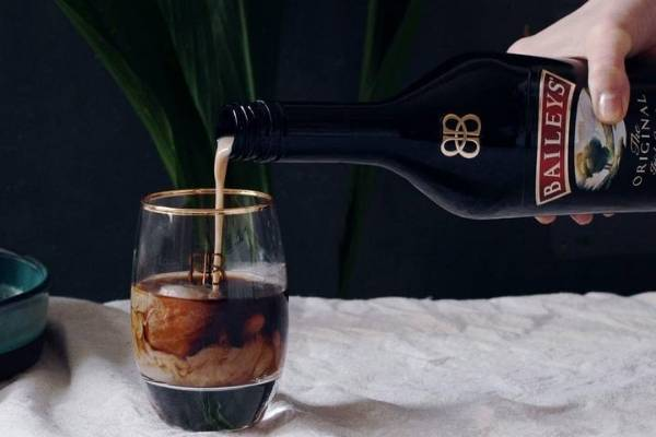 Pouring Baileys In Coffee