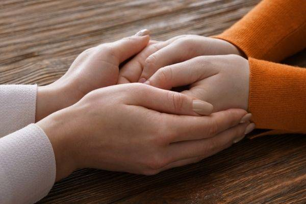 Friend Holding Hand And Comforting, Heartbreak Survival Guide