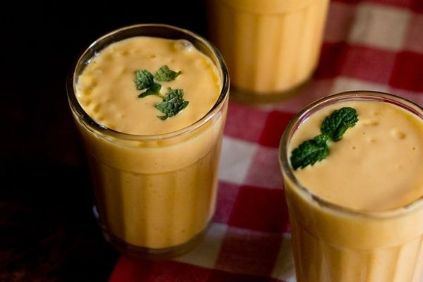 Mango lassis topped with mint leaves