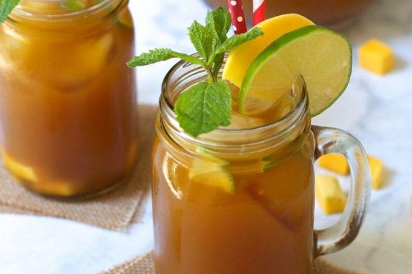 Mango iced tea garnished with lemon and mint