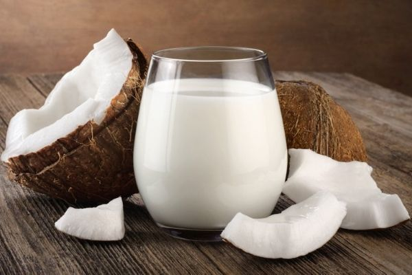 Dairy-free coconut milk in a transparent glass