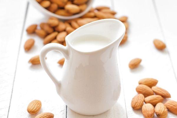 Vegan Milk Recipes: An image of almond milk in a white jug