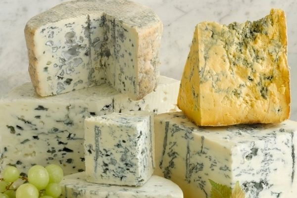 Blue-Veined Cheese: A variety of blue veined cheeses kept together