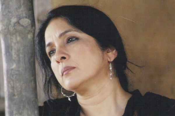 Neena Gupta's Autobiography: Neena Gupta is seen in a still from one of her films in a black suit